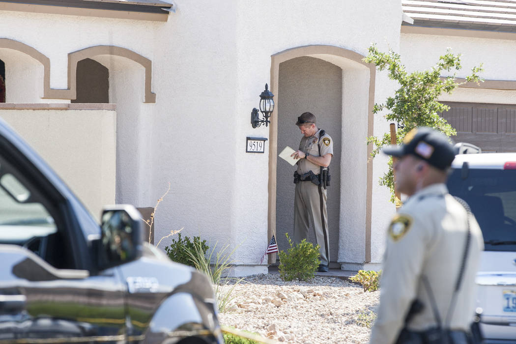 A police officer stands in the doorway of a house after a child shot himself on Chandler Springs Avenue in southwest Las Vegas on Tuesday, Aug. 1, 2017. (Patrick Connolly Las Vegas Review-Journal) ...
