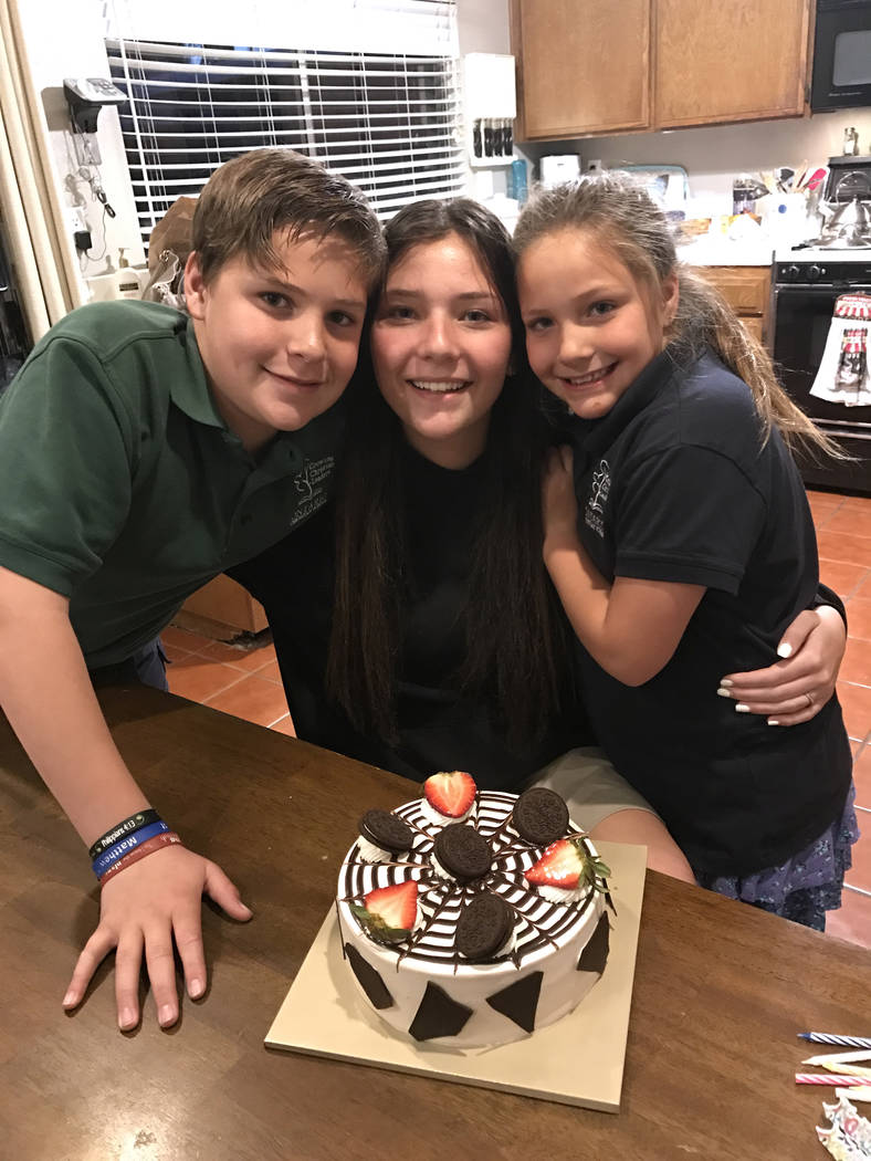 Micaela Miller, 16, center, Noah Miller,12, left, and Madison Miller, 8, made a cake for their late mother Sheila Miller on her birthday on March 1, 2017. Both parents died in a car crash in 2010. ...