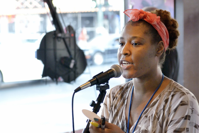 Organizer Vogue Robinson makes an announcement during a poetry slam sponsored by the Battle Born slam poetry team at The Beat Coffeehouse and Records at 520 Fremont St. in Las Vegas on Friday, Jul ...