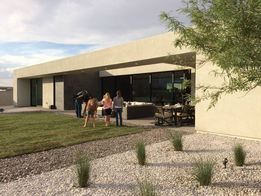 House viewers gather in the backyard. The 2017 St. Jude Dream Home features a finished patio with barbecue kitchen. Ticket sales benefited St. Jude's hospital. (Jan Hogan/View)
