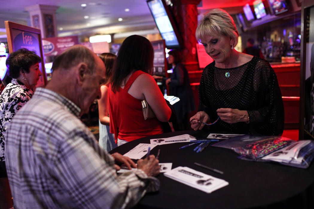 Richard Sedler of Las Vegas, left, signs up with Kathy Cornelius of the Frankie Moreno Fan Club, right, before a concert at the Suncoast Showroom in Las Vegas, Saturday, Sept. 9, 2017. Joel Angel  ...
