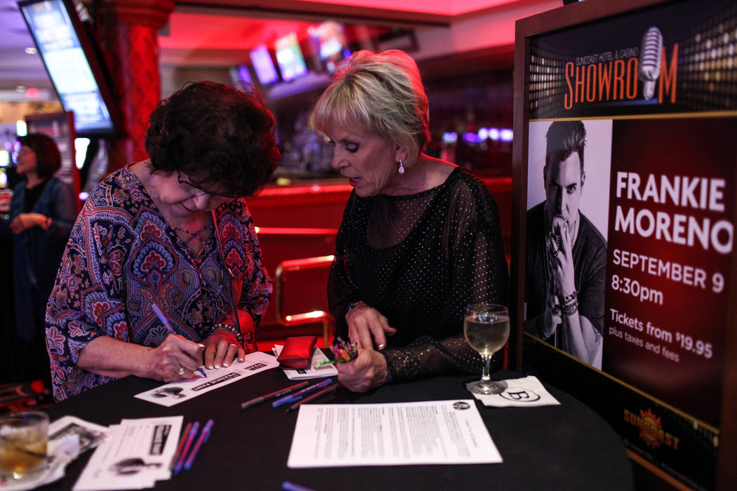 Adrianne Kotil of Las Vegas, left, signs up with Kathy Cornelius of the Frankie Moreno Fan Club, right, before a concert at the Suncoast Showroom in Las Vegas, Saturday, Sept. 9, 2017. Joel Angel  ...