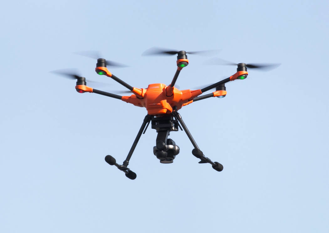 The Yuneec H520, unmanned aircraft system, flies over an accident reconstruction as Yuneec and the Nevada Highway patrol demonstrate the latest commercial sUAS on Thursday, Sept. 7, 2017, outside  ...