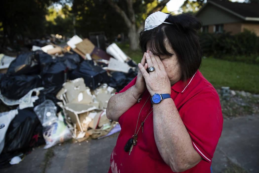 Peggy Lanigan pauses Wednesday as she speaks with The Associated Press in the aftermath of Hurricane Harvey in Houston. Harvey's record-setting rains now have the potential to set records for the  ...