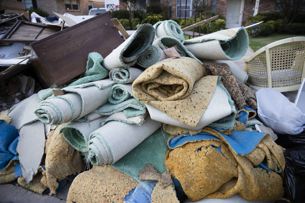 Flood damaged carpet sits in front of a home Wednesday in the aftermath of Hurricane Harvey in Houston. Harvey's record-setting rains now have the potential to set records for the amount of debris ...