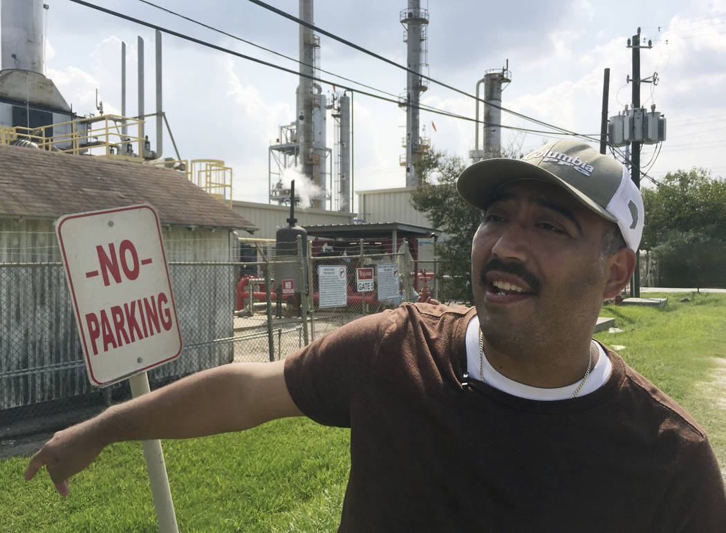Community environmental activist Juan Flores talks a reporter in Galena Park, Texas, on Saturday, Sept. 2. Petrochemical corridor residents say air that is bad enough on normal days got unbearable ...