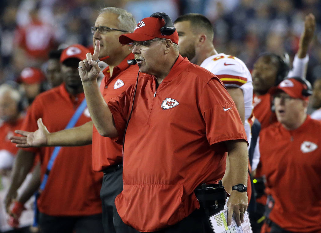 Kansas City Chiefs head coach Andy Reid gives instructions from the sideline during the second half of an NFL football game against the New England Patriots, Thursday, Sept. 7, 2017, in Foxborough ...