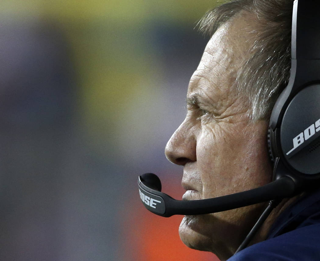 New England Patriots head coach Bill Belichick watches play from the sideline during the second half of an NFL football game against the Kansas City Chiefs, Thursday, Sept. 7, 2017, in Foxborough, ...