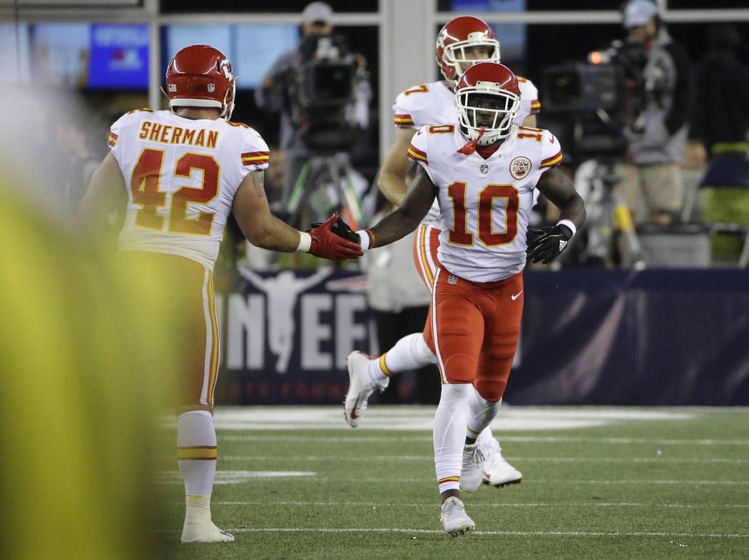 Kansas City Chiefs fullback Anthony Sherman (42) congratulates wide receiver Tyreek Hill (10) on his touchdown against the New England Patriots during the second half of an NFL football game, Thur ...