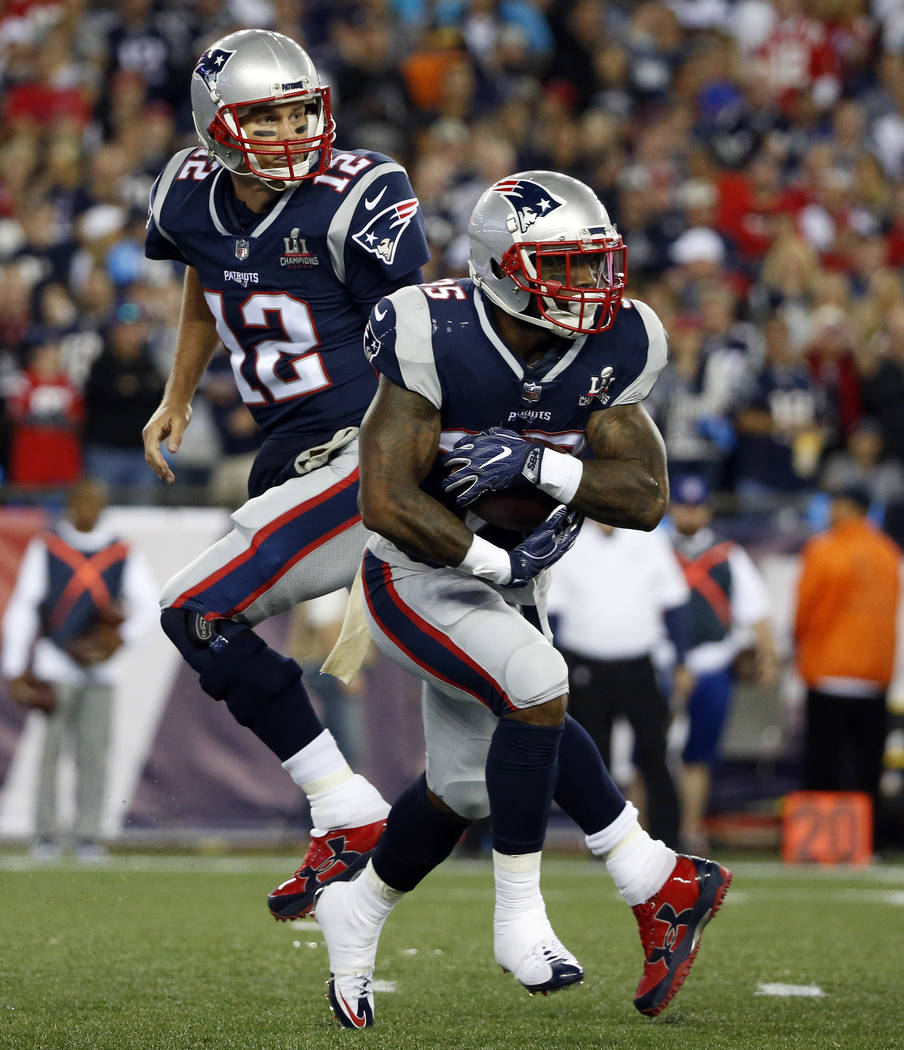 New England Patriots running back Mike Gillislee takes a handoff from quarterback Tom Brady, rear, during the first half of an NFL football game against the Kansas City Chiefs, Thursday, Sept. 7,  ...