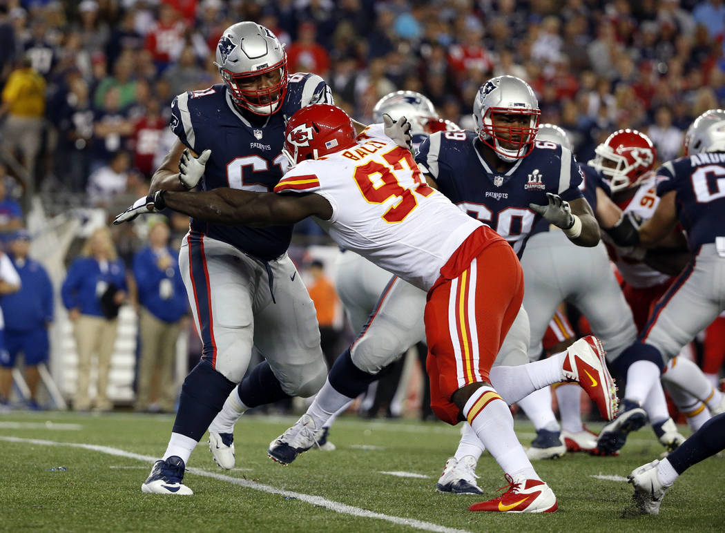 New England Patriots tackle Marcus Cannon, left, blocks Kansas City Chiefs linebacker Justin Houston (50) during the second half of an NFL football game, Thursday, Sept. 7, 2017, in Foxborough, Ma ...