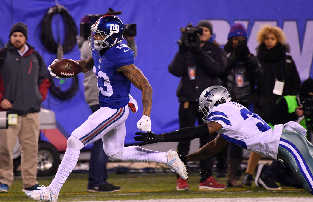 Dec 11, 2016; East Rutherford, NJ, USA;  New York Giants wide receiver Odell Beckham (13) scores the game winning TD in the second half against the Dallas Cowboys at MetLife Stadium. Mandatory Cre ...