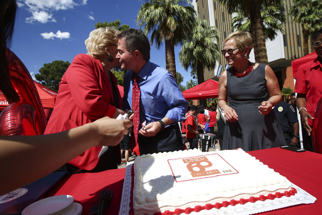 Las Vegas Mayor Carolyn Goodman, left, hugs UNLV President Len Jessup as Diane Chase, executive vice president and provost at the school, looks on during an event marking UNLV's 60th birthday at P ...