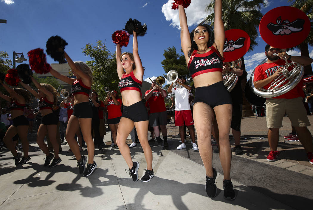 Members of the UNLV pom team and marching band perform during an event marking UNLV's 60th birthday at Pida Plaza on the school's campus in Las Vegas on Tuesday, Sept. 12, 2017. Chase Stevens Las  ...