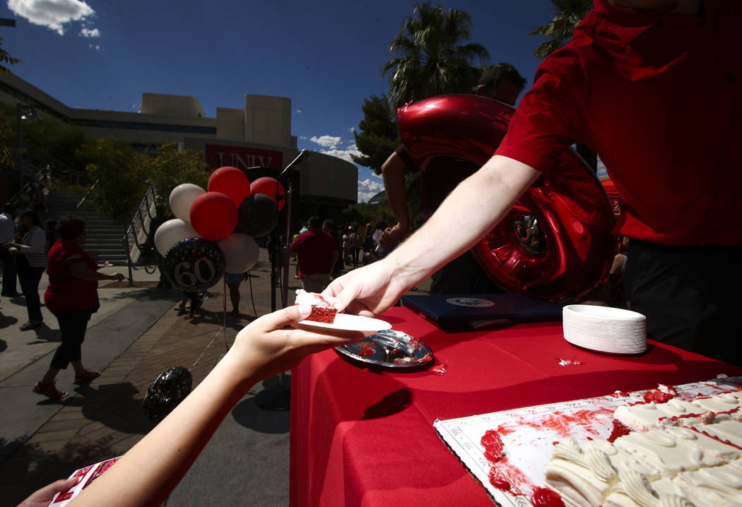 Cake is handed out during an event marking UNLV's 60th birthday at Pida Plaza on the school's campus in Las Vegas on Tuesday, Sept. 12, 2017. Chase Stevens Las Vegas Review-Journal @csstevensphoto