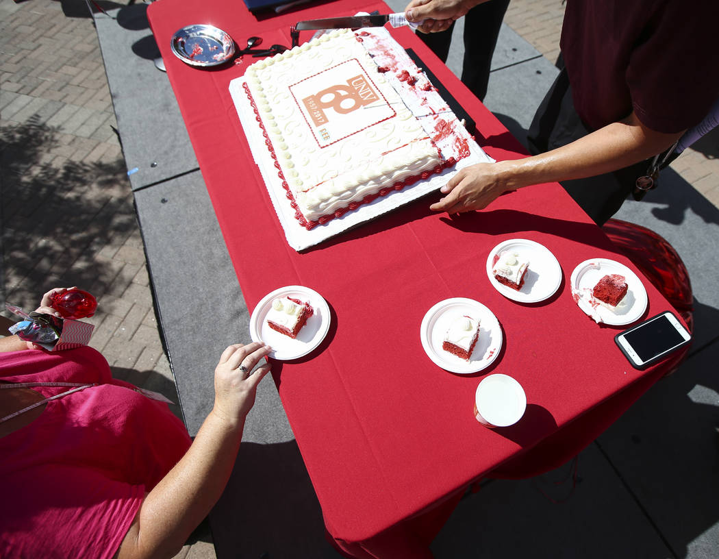 UNLV Dining catering lead Adam Leitner cuts pieces of cake during an event marking UNLV's 60th birthday at Pida Plaza on the school's campus in Las Vegas on Tuesday, Sept. 12, 2017. Chase Stevens  ...