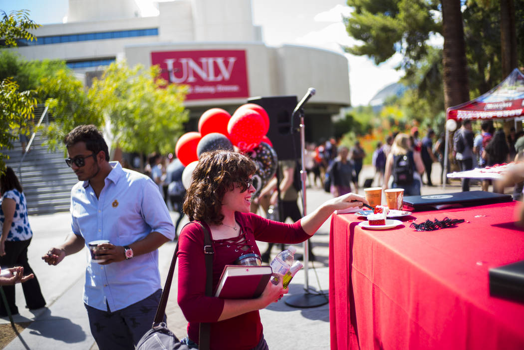 A student grabs a piece of cake during an event marking UNLV's 60th birthday at Pida Plaza on the school's campus in Las Vegas on Tuesday, Sept. 12, 2017. Chase Stevens Las Vegas Review-Journal @c ...