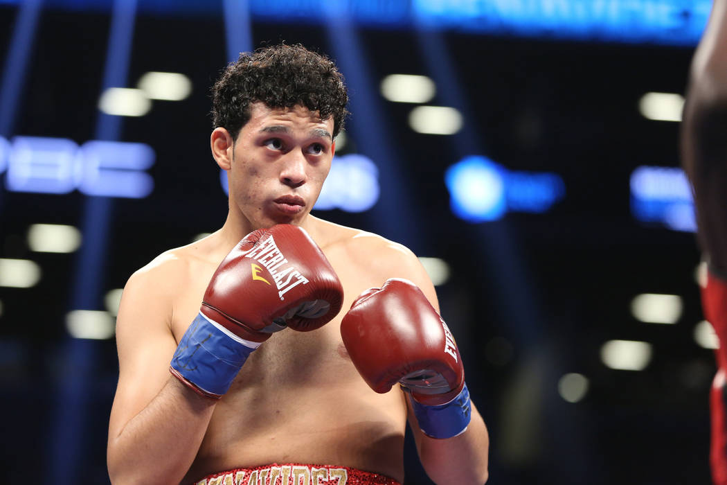 David Benavidez,  in action against Francy Ntetu during their fight at the Barclays Center in Brooklyn, on Saturday, June 25, 2016. Benavides won via TKO. (AP Photo/Gregory Payan)