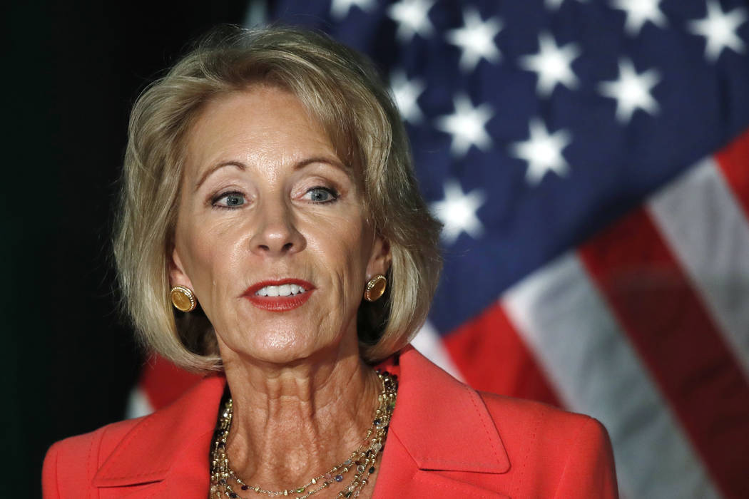 Education Secretary Betsy DeVos speaks about campus sexual assault and enforcement of Title IX, the federal law that bars discrimination in education on the basis of gender, Thursday, Sept. 7, 201 ...