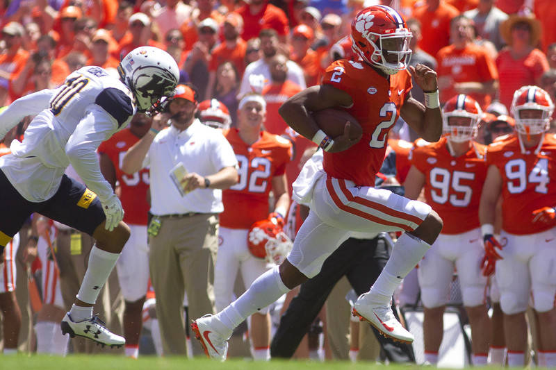 Sep 2, 2017; Clemson, SC, USA; Clemson Tigers quarterback Kelly Bryant (2) carries the ball while being defended by Kent State Golden Flashes wide receiver Kavious Price (10) during the first half ...