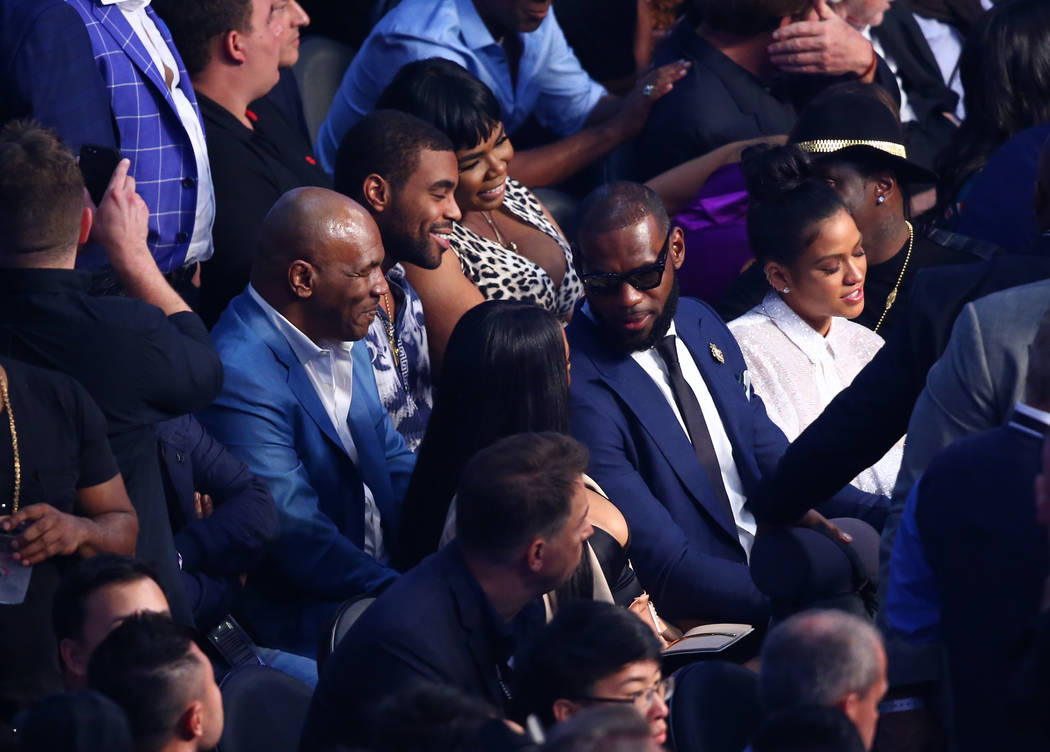 Former boxer Mike Tyson, left, and NBA superstar Lebron James seated before the Floyd Mayweather Jr. and Conor McGregor fight at T-Mobile Arena, Saturday, Aug. 26, 2017, in Las Vegas. Chase Steven ...