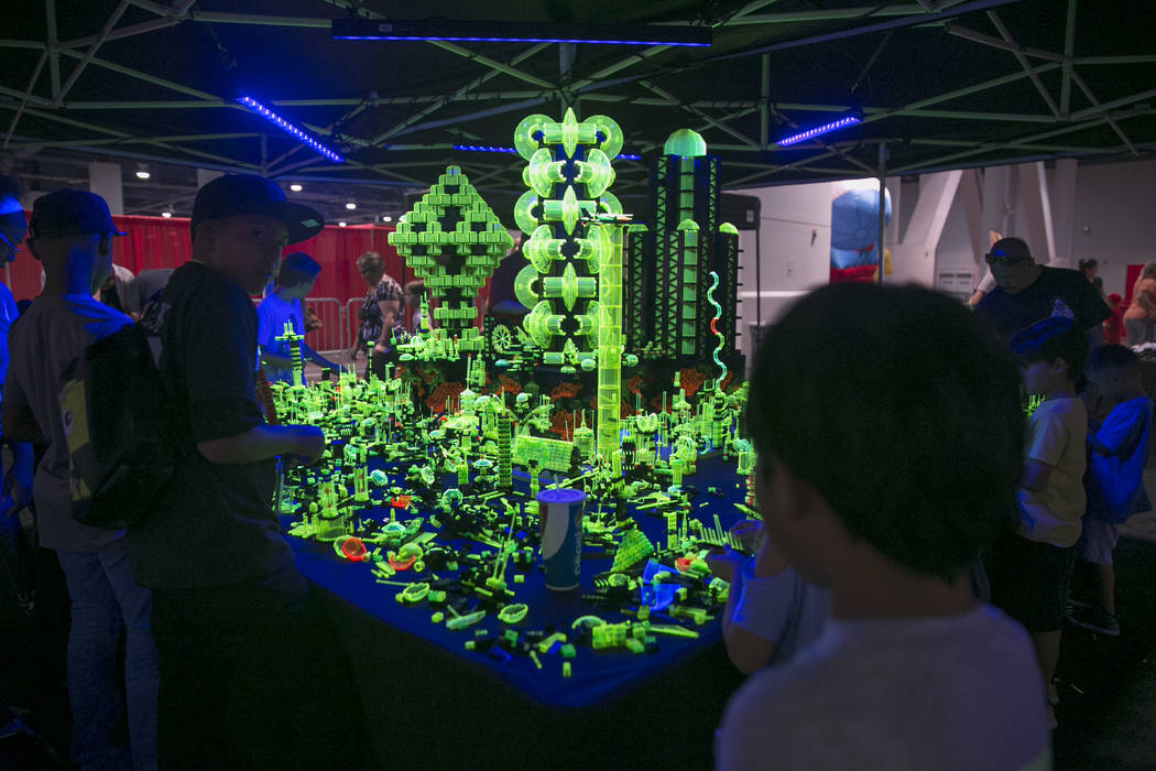 Attendees add their own creations to the Neon City display during Brick Fest Live! at the Las Vegas Convention Center in  Las Vegas on Saturday, Sept. 9, 2017. Gabriella Angotti-Jones Las Vegas Re ...