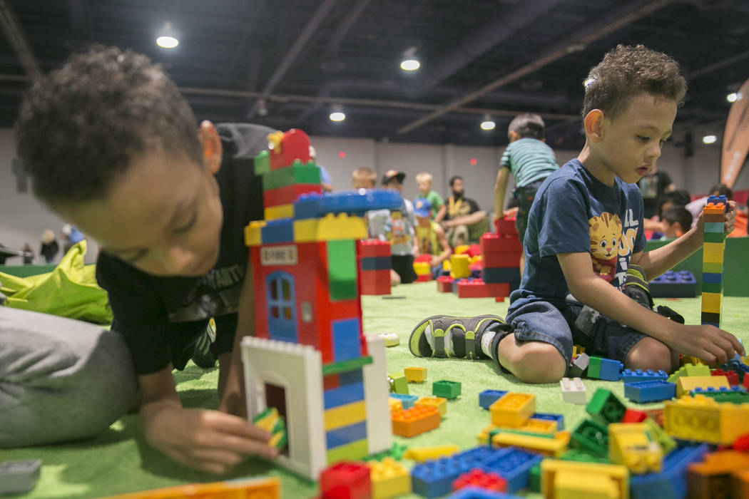 Deon Shepherd, 5, left, and his twin brother Ason Shepherd, 5, play in a LEGO pit during Brick Fest Live! at the Las Vegas Convention Center in Las Vegas on Saturday, Sept. 9, 2017. Gabriella Ango ...
