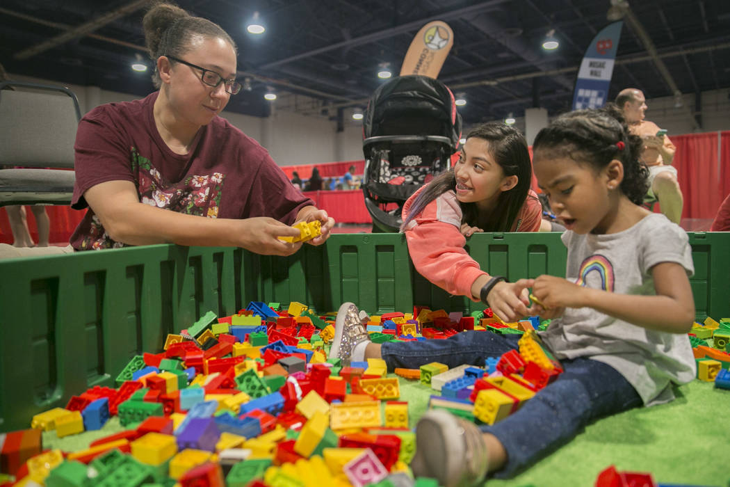 Kathy Turizo, 33, from left, Addy Toscano, 13 and Trulie Johnson, 3, play in a LEGO pit during Brick Fest Live! at the Las Vegas Convention Center in Las Vegas on Saturday, Sept. 9, 2017. Gabriell ...