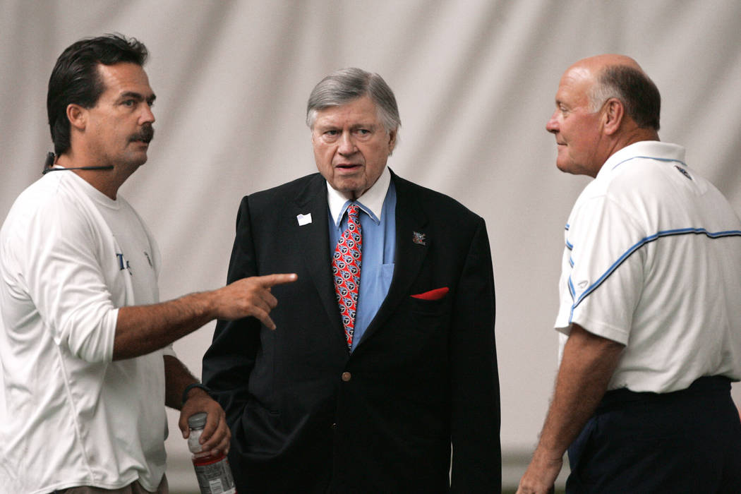 ** FILE ** Tennessee Titans owner Bud Adams, center, talks with coach Jeff Fisher, left, and general manager Floyd Reese, right, on Aug. 3, 2004, in Nashville, Tenn.  The Titans announced Friday,  ...