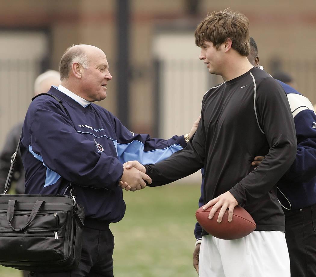 ** ADVANCE FOR WEEKEND EDITIONS, APRIL 22-23 ** Tennessee Titans general manager Floyd  Reese, left, greets Vanderbilt quarterback Jack Cutler after Cutler worked out for NFL scouts at Vanderbilt' ...
