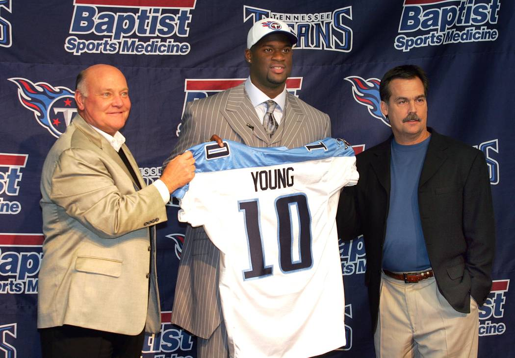 Former Texas quarterback Vince Young who was the third overall pick in the first round of the NFL Draft selected the Tennessee Titans is pictured holding a Titans jersey with Titans general manage ...
