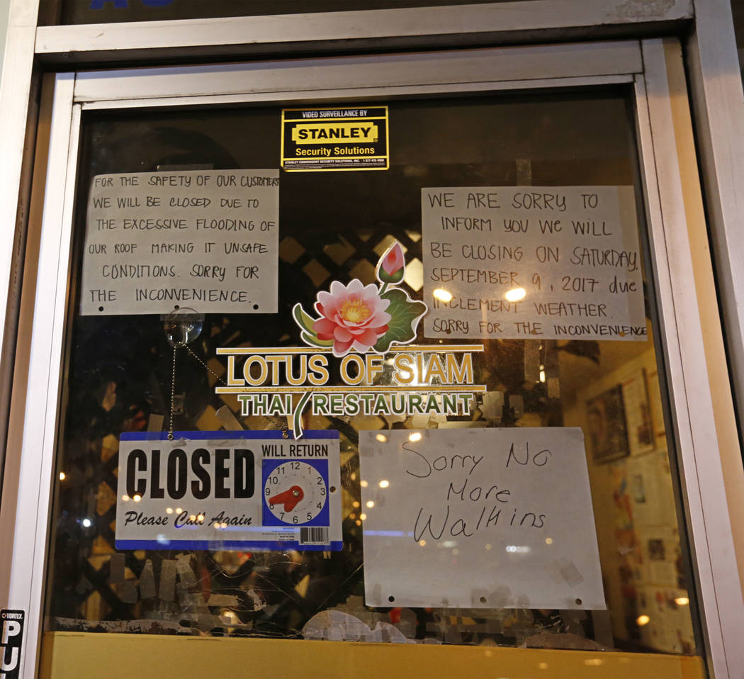 A few signs are posted at the entrance of Thai restaurant Lotus of Siam after a portion of its ceiling collapsed  in Las Vegas, Friday, Sept. 8, 2017. Chitose Suzuki Las Vegas Review-Journal @chit ...