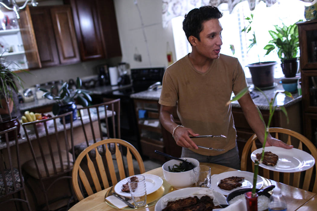 Deferred Action for Childhood Arrival program recipient Johan Gaytan prepares dinner inside his Las Vegas home Thursday, Sept. 7, 2017. Joel Angel Juarez Las Vegas Review-Journal @jajuarezphoto