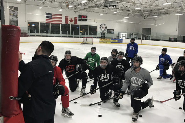 UNLV hockey coach Anthony Vignieri Greener diagrams a play during a practice last season at the Las Vegas Ice Center. The Rebels have made the jump from Division 2 to Division 1 in the American Co ...