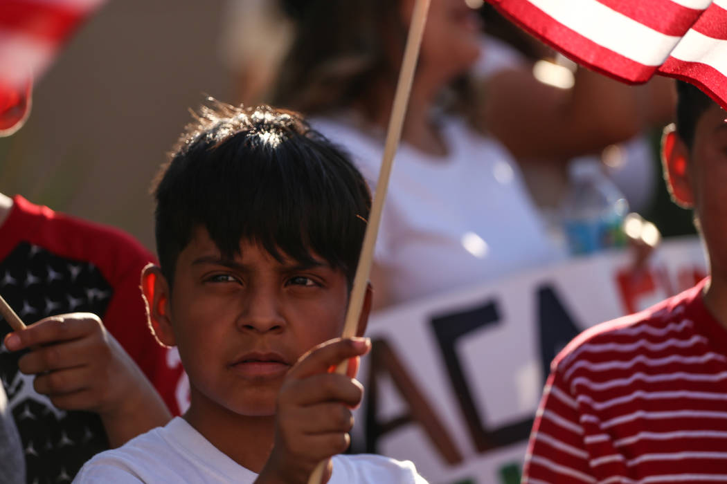 Several hundred DACA recipients and supporters including Angel Meneses, 9, march down the Strip in Las Vegas, Sunday, Sept. 10, 2017, to call on President Donald Trump and Nevada elected officials ...
