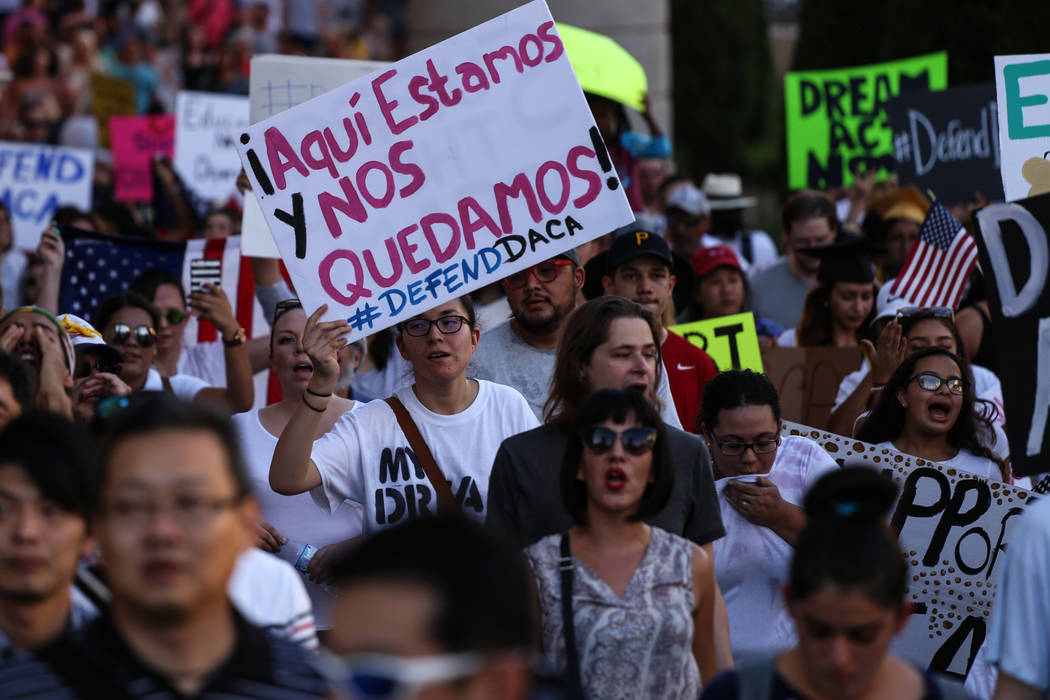 Several hundred DACA recipients and supporters including Maria Garcia De Los Santos, center, march down the Strip in Las Vegas, Sunday, Sept. 10, 2017, to call on President Donald Trump and Nevada ...