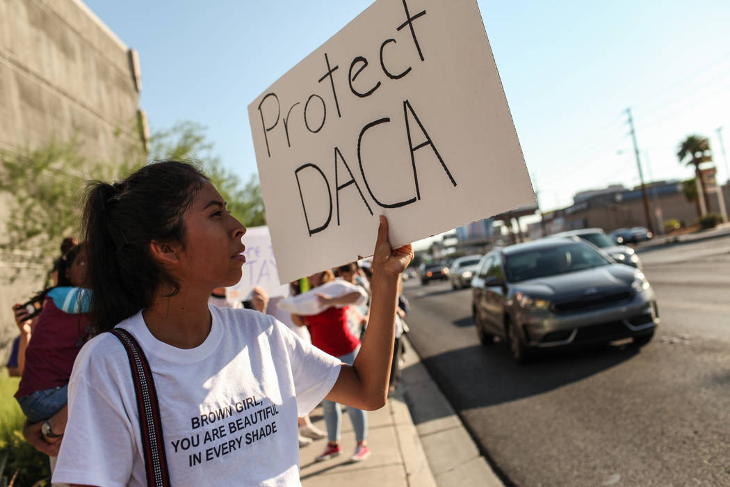 Several hundred DACA recipients and supporters including Itzel Gallegos march down the Strip in Las Vegas, Sunday, Sept. 10, 2017, to call on President Donald Trump and Nevada elected officials to ...