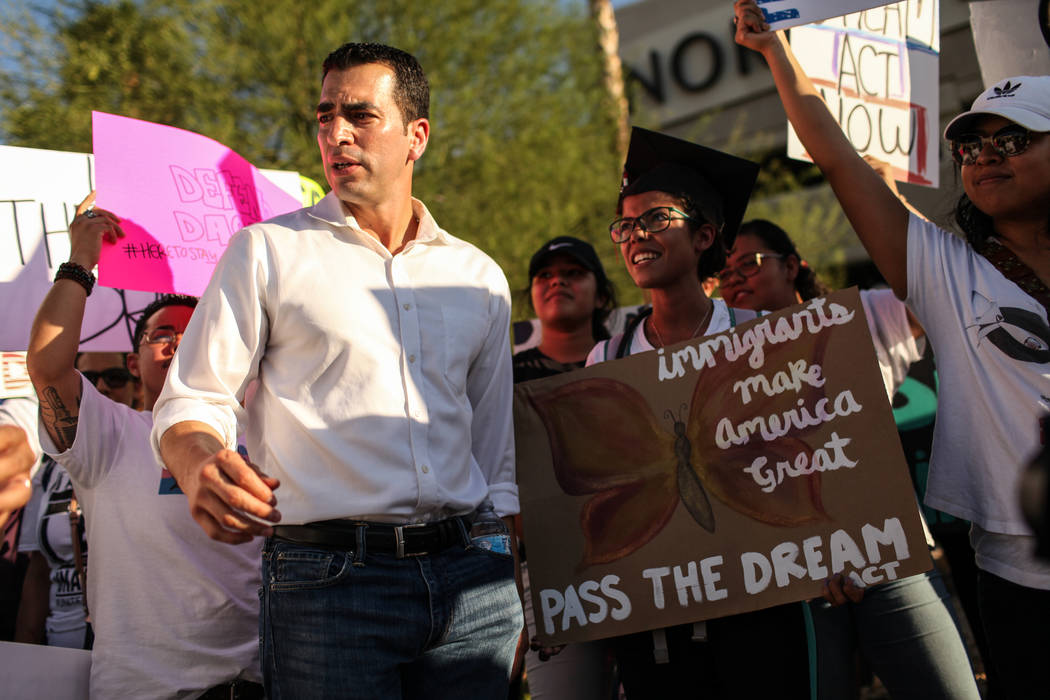 Several hundred DACA recipients and supporters including Rep. Ruben J. Kihuen, left, and UNLV graduate Marcela Rodriguez Campo, right,  march down the Strip in Las Vegas, Sunday, Sept. 10, 2017, t ...