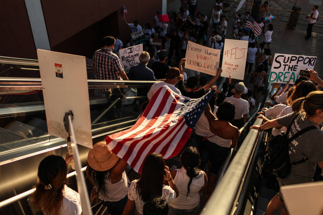 Several hundred DACA recipients and supporters march down the Strip in Las Vegas, Sunday, Sept. 10, 2017, to call on President Donald Trump and Nevada elected officials to protect the Obama-era in ...
