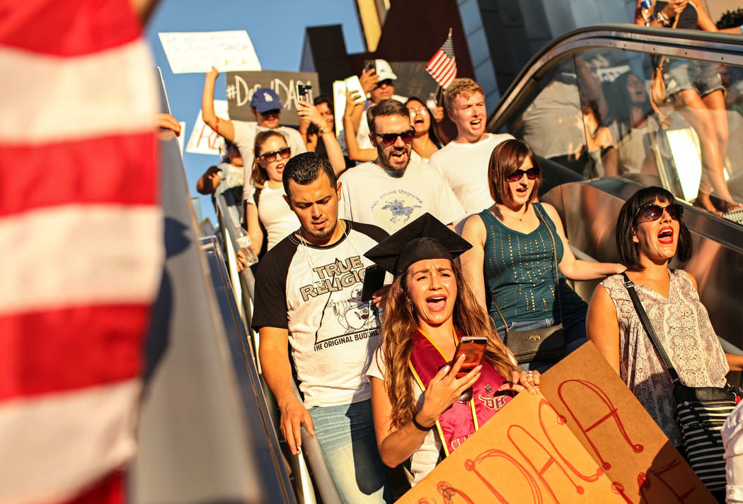 Several hundred DACA recipients and supporters including Miriam Garcia, a graduate from California State University, Dominguez Hills, march down the Strip in Las Vegas, Sunday, Sept. 10, 2017, to  ...