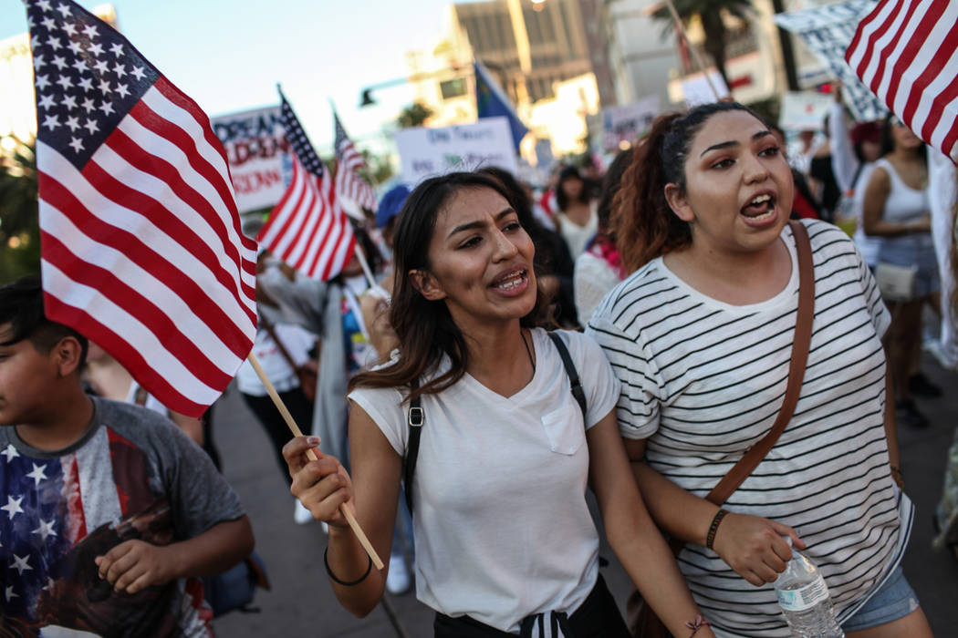 Several hundred DACA recipients and supporters including Lizbeth Godoy-Lua, left, and Graciela Zamarripa, right, march down the Strip in Las Vegas, Sunday, Sept. 10, 2017, to call on President Don ...