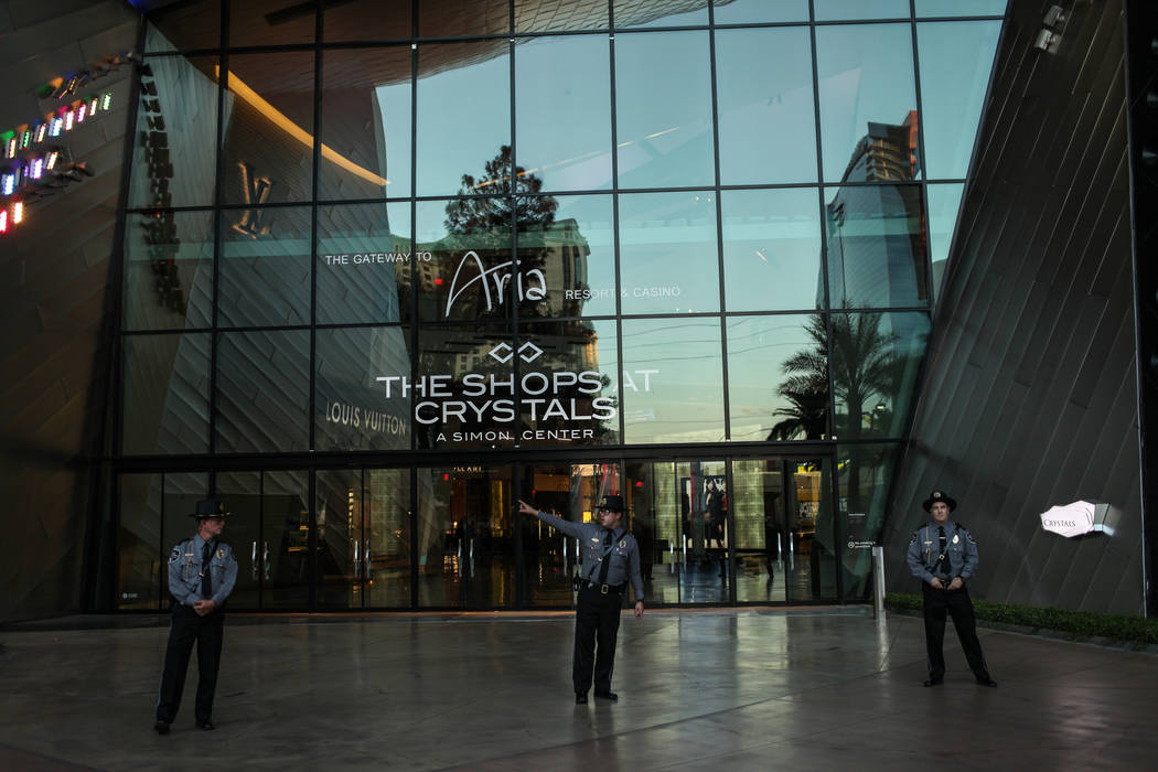 Security personnel block the entrance to the Aria as several hundred DACA recipients and supporters march down the Strip in Las Vegas, Sunday, Sept. 10, 2017, to call on President Donald Trump and ...