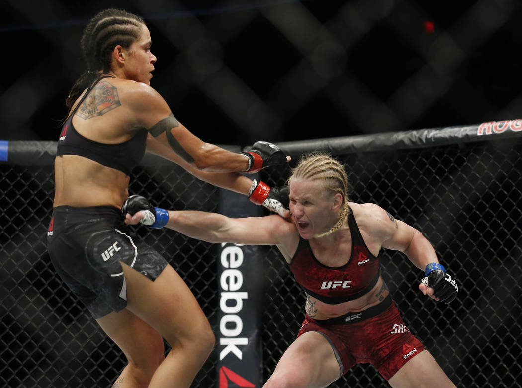Sep 9, 2017; Edmonton, Alberta, Canada;  Amanda Nunes (red gloves) fights Valentina Shevchenko (blue gloves) during UFC 215 at Rogers Place. Mandatory Credit: Perry Nelson-USA TODAY Sports