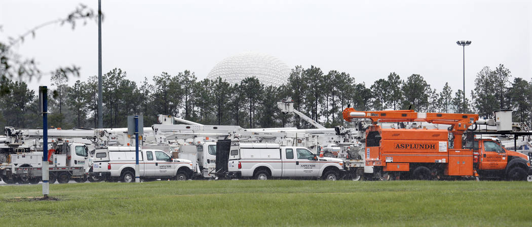 The 'Spaceship Earth' dome looms above a fleet of utility trucks parked in a parking lot at Disney's Epcot theme park ahead of the arrival of Hurricane Irma in Kissimmee, Florida, U.S., September  ...