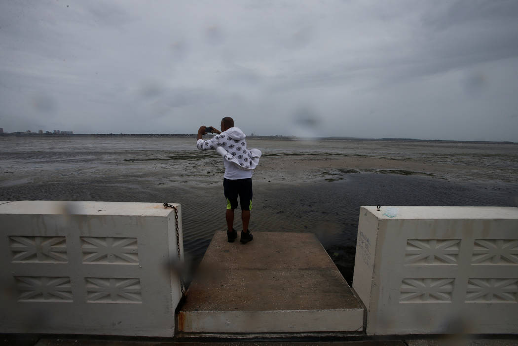 A man photographs Hillsborough Bay after water receded from the harbour ahead of the arrival of Hurricane Irma in Tampa, Florida, U.S., September 10, 2017. (Chris Wattie/reuters)