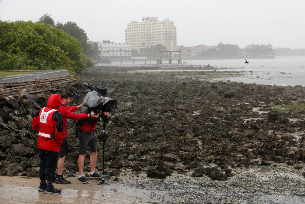 A video crew films Hillsborough Bay after water receded from the harbour ahead of the arrival of Hurricane Irma in Tampa, Florida, U.S., September 10, 2017. (Chris Wattie/reuters)