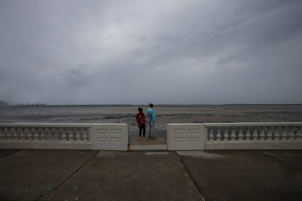 Boys look out at Hillsborough Bay after water receded from the harbour ahead of the arrival of Hurricane Irma in Tampa, Florida, U.S., September 10, 2017. (Chris Wattie/reuters)