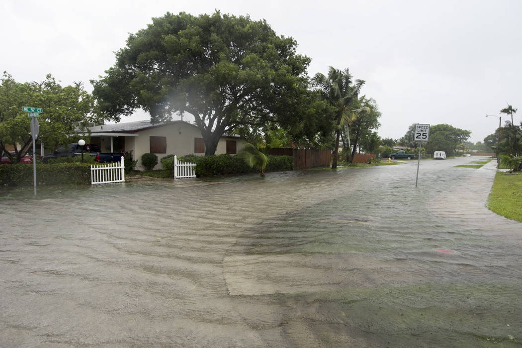 A flooded street is seen in a residential neighborhood in Fort Lauderdale, Fla., as Hurricane Irma blows in Sunday, Sept. 10, 2017. (Paul Chiasson/The Canadian Press via AP)