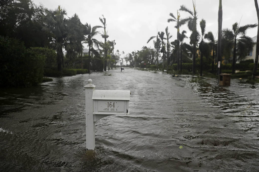 A street is flooded as Hurricane Irma passes through Naples, Fla., Sunday, Sept. 10, 2017. (AP Photo/David Goldman)