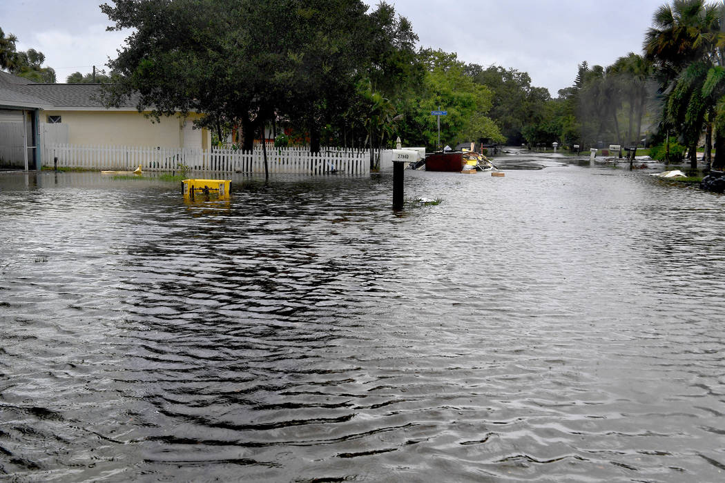 Many streets in the Bonita Springs, Florida, area were flooded by mid-morning on Sunday. (Michael S. Williamson/Washington Post)